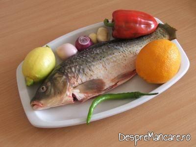Ingrediente pentru crap cu legume, lamai si portocale la cuptor.