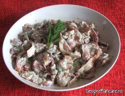 Delicatesa din urechi de porc, afumate, servite de ziua Romaniei 1 Decembrie.