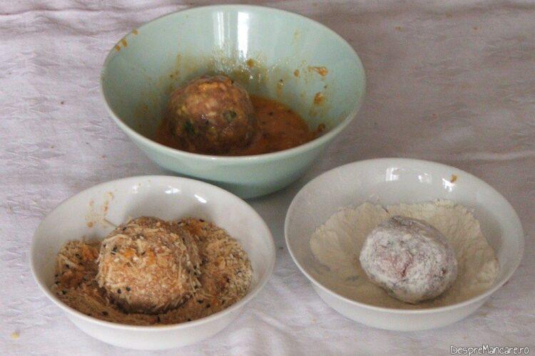 Tavalire guguloaie din carne tocata prin faina, ou batut, pesmet, ou batut in vederea prajirii in ulei incins.