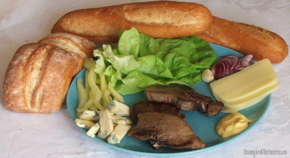 Ingrediente pentru sandvis rece cu limba de vaca, fiarta si rumenita.